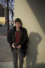 (Caitlin H. Faw) Tags: street camera light shadow portrait usa man adam look digital standing canon eos rebel md nikon december glare maryland jacket bethesda glance 2011 d90 woodmonttriangle fairmontavenue t1i caitlinfaw