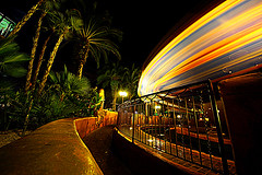 Feel the Heat (. Jianwei .) Tags: longexposure light yellow night fence disneyland spin wideangle disney trail le 365 8mm magickingdom a500 themagiccarpetsofaladdin jianwei kemily
