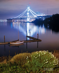 Judge Smails Yacht meets the new Oakland Bay Bridge (Darvin Atkeson) Tags: sanfrancisco bridge seascape landscape oakland bay earthquake construction treasureisland suspension baybridge quake 1989 yerbabuenaisland darvin atkeson darv liquidmoonlightcom lomapreta