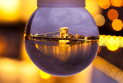 Budapest Chain Bridge - Szchenyi Lnchd (Crazy Ivory) Tags: bridge light orange macro reflection water yellow night contrast canon river dawn lights evening nice interesting blurry hungary glow purple bokeh dusk streetlamps streetlights budapest wideangle bowl warped sharp fisheye snowball bluehour dots duna ungarn danube buda pest kettenbrcke unsharp donau canon100mmmacro glassball glassbowl chainbridge szchenyilnchd lanchid canon100mmf28macrousm 40d canoneos40d canon100mm28usm szchenyikettenbrcke gettygermanyq4