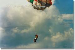 just dropping in (jjamv) Tags: ocean travel sea sky bali macro texture beach clouds indonesia temple asia fuji mju zoom postcard olympus timor mjuii ubud kuta parachute olympusmju houtduif 27798 anzichtkaart 100commentgroup jjamv texturebypicnik julesvtravel olympuszoom105 rememberthatmomentlevel1 bali98 olympusumjuzoom105 juliusvloothuis