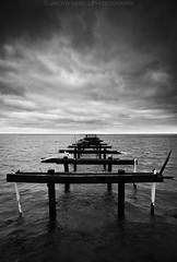 Decrepit (Jack Wassell) Tags: ocean old sea sky blackandwhite seascape broken water clouds pier dock angle connecticut wide bridgeport decrepit longislandsound sigma1020mm seasidepark hitech09softgrad