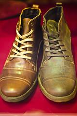 Odd Boots (garryknight) Tags: 50mmf18 creativecommons d5100 london nikon boot footwear lightroom odd shoe shop window