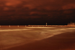 A Cold and Spooky Night Down By North Ave.Beach (Seth Oliver Photographic Art) Tags: nightphotography chicago clouds landscapes illinois nikon midwest waves iso400 lakes lakemichigan beaches nightshots pinoy nightscapes secondcity northavenuebeach windycity longexposures chicagoist d90 nightexposures 10secondexposure handheldshot cityofchicago cityofbigshoulders aperturef90 manualmodeexposure setholiver1 tripodmountedshot 1024mmtamronuwalens northavenuebeachlighthouse