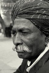Indian Villager (Shekhar Suri) Tags: old musician man canon dark eos google asia flickr thought folk song indian award oldman images turban rajasthan villager anawesomeshot flickraward