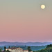 Moonrise over tuscany farm