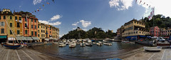 (The New Motive Power) Tags: blue italy panorama water architecture bar port landscape boats cafe fishing dock warm village bright harbour small wide perspective canond60 sunny tourists quay resort busy genoa shops yachts activity distance portofino slope slipway italianriviera comune