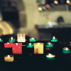 candles (soreikea) Tags: light paris color church dark candles shadows kodak pray montsaintmichel  worldheritagesites 2011  portra160  zenzabronica