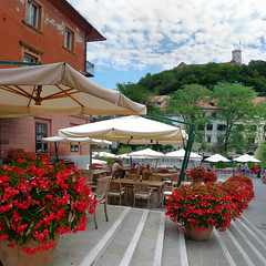 Inviting flower terrace in the beloved old Ljubljana (Bn) Tags: street old city trip flowers summer people holiday streets men castle history church river walking square geotagged restaurant town topf50 women energy europe child market terrace small hill capital sightseeing relaxing scenic atmosphere pedestrian down charm tourist architect musical congress slovenia orchestra shops ljubljana local tradition baroque grad wandering beloved laibach strolling ljubljanica lubiana 50faves ljubljanski joe plenikits geo:lon=14505301 geo:lat=46048440