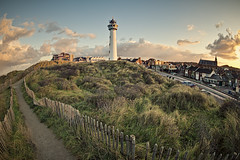 Planet Egmond (Allard One) Tags: morning autumn sky urban test lighthouse distortion holland fall church netherlands clouds sunrise way nikon december village path dunes horizon herfst pad nederland wideangle fisheye 180 planet bergen lucht 16mm morgen duinen eclectic vuurtoren harsh bold gettyimages noordholland egmond dutchlandscape zonsopgang 180degrees paaltjes inyourface bolling 2011 egmondaanzee northholland groothoek beautyinnature paadje distortedreality touristdestination 5xp nikcolorefexpro hekjes wideangleview ronding hieraandekust d700 enfuse coastalvillage jcjvanspeijk kustplaats nikond700 nikonfx nikkor16mmf28fisheye allardone slingerend allard1 wanderingroad duohardstrak 180graden fullframepower kijkplaat