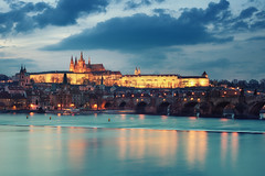 Icy Water (Philipp Klinger Photography) Tags: city longexposure bridge blue light shadow sky orange cloud color reflection water saint yellow statue night clouds river gold golden evening nikon colorful europa europe long exposure republic nocturnal czech prague saints illumination vivid sta