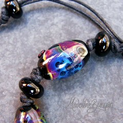 "Black and Muted Rainbow Beads Lampwork Bead Bracelet on cord • <a style=""font-size:0.8em;"" href=""https://www.flickr.com/photos/37516896@N05/6499727103/"" target=""_blank"">View on Flickr</a>"