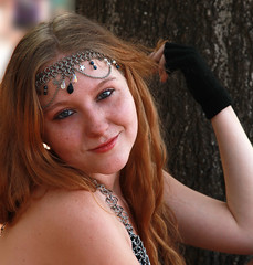 Hope Plays With Her Hair (wyojones) Tags: woman usa cute girl beautiful beauty smile look festival hope eyes pretty texas hand teeth blueeyes trf redhead glove faire redlips freckles lovely fest jewels redhair renaissance renfest headband wench texasrenaissancefestival toddmission chaimail wyojones
