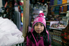 The Girl In The Store (Rob Chiu) Tags: pink girl smile store shoot guatemala magenta antigua canon5d marketplace 24mm 14l