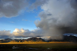 Gang Ti Se Mt range in sunset and a very local blizzard, Tibet