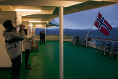 Photographing the flag (AdamKR) Tags: christmas uk cruise norway circle sony north arctic alpha dslr nordnorge hurtigruten 2011 a550