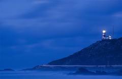 The last light before the abyss. (Xabier Alonso) Tags: longexposure blue light sea lighthouse azul night faro noche coast mar nikon nightlight noite bluehour oia vigo nationalgeographic baiona exposicinlarga riadevigo cabosilleiro d3000 mougs nikond3000 santamariadeoia mygearandme mygearandmepremium mygearandmebronze