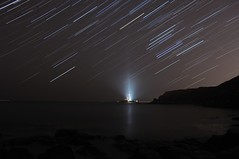 St Mary's Star Trail (Nicholas Gray) Tags: light sea england cliff lighthouse house mist motion blur beach st rock fog speed island star bay coast solar high movement sand aperture nikon rocks long exposure raw ray open slow streak live tide mary north trails move astro stack illuminated system east beam trail northumberland coastal northumbria bbc orion shutter ambient astronomy universe gaze beacon astrology stacked constellation hartley illuminate astronomical stargazing d300 startrail whitley marys startrailsde