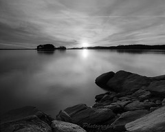 Sundown (John Cothron) Tags: winter sunset sky blackandwhite bw cloud sun cold color reflection film nature monochrome rock mediumformat georgia landscape twilight outdoor dusk gainesville lakeshore lakelanier fujineopan100acros lowwaterlevel hallcounty mamiyarz67proii mountainviewpark brownsbridgeroad johncothron cothronphotography sekorz50mmf45w