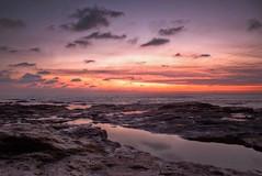 Bandra Sunset (Vivek R. Singh: Visual Artist) Tags: sunset sky india beach canon landscape raw photographer bombay maharashtra 1855mm mumbai bandstand hdr filmmaker bandra asiasociety rebelt1i vivekrajsingh vivekrsingh vivekrsinghvisualartist longexposure500d