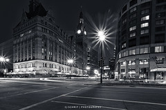 Water & Kilbourn (CJ Schmit) Tags: longexposure urban usa monochrome wisconsin architecture canon buildings lowlight downtown cityscape unitedstates streetlights cityhall milwaukee lighttrails toned waterstreet canonef1740mmf40lusm kilbournavenue portalwisconsinorgselected 5dmarkii canon5dmarkii cjschmit wwwcjschmitcom niksilverefexpro2 cjschmitphotography portalwisconsinorg021312