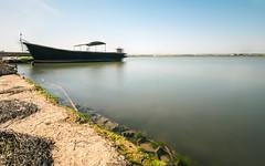 Calma piatta sulle rive... (Minieri Nicola) Tags: sea sky lake beach beautiful landscape lago barca mare calma longexposition lungaesposizione