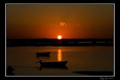 Touching the horizon (Hugo Carvoeira) Tags: sunset orange cloud sun portugal faro boats nikon day ii end algarve nikkor 18200 vr d7000