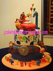 Cowboy theme birthday cake (Jcakehomemade) Tags: celebration charactercake partycake fondantcake noveltycake lightningmcqueencake designercake 3dcake cartooncake toystorycake wwwjcakehomemadeblogspotcom jessicalaw customizedbirthdaycake childrennoveltycake cowboythemebirthdaycake happyfirstbirthdaycake shivanthsbirthday