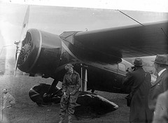 Amelia Earhart at Derry (National Library of Ireland on The Commons) Tags: camera ireland woman dog pet hat animal 1932 plane airplane thirties 1930s photographer aircraft aviation wheels flight may hound cockpit aeroplane gloves londonderry northernireland lockheed vega aviator pilot derry propellor journalists ulster earhart canis lockheedvega flyingsuit ameliaearhart aviatrix transatlanticflight nationallibraryofireland littleredbus lockheedaircraft lockheed5b vega5 nr7952 lockheedvega5 lockheedvega5b vega5b lockheed5bvega lockheed5vega lockheed5 lockheedmodel5vega lockheedmodel5 independentnewspaperscollection lockheedmodel5bvega lockheedmodel5b lockheedvegamodel5 mrsgeorgepalmerputnam lockheedvegamodel5b