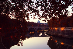 The World is Soft (dragov) Tags: bridge autumn shadow italy rome roma reflection leaves foglie river 50mm lights evening nikon fiume ponte trastevere explore tevere luci sanpietro autunno lazio riflesso saintpeter nikond60 vincenzodragone