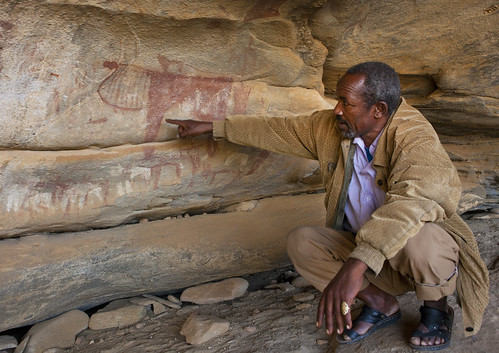 Laas Geel Rock Art Caves, Squatting Guide Explaining Meaning Of Paintings