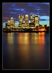 Docklands at night (adrians_art) Tags: city longexposure windows sky cloud motion london water night buildings reflections movement skyscrapers streetlamps docklands canarywharf riverthames hsbc offices barclays towerblocks isleofdogs citybank