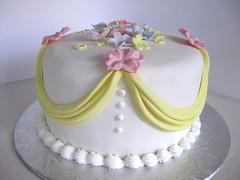 Floral Swag cake (ilovechrissycakes) Tags: wedding woman baby yellow cake shower bride purple swiss violet layer romantic ribbon pearl chic petunia bridal meringue shabby chocolatevanillabuttercreamfondant swagpink gumpastekidschildbirthdaypartygirlboycustomquebecstlazarehudson