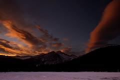 Sunrise over Long's Peak [Explore] (mclcbooks) Tags: morning winter sky orange lake snow mountains clouds sunrise landscape dawn colorado rmnp longspeak rockymountainnationalpark bearlake lakescape