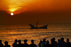 Sunset at Cox's Bazar Beach (Tipu Kibria~~BUSY~~) Tags: sunset red sea people sun fish beach nature water clouds canon eos evening boat colours lifestyle 7d fishingboat bangladesh daybreak bayofbengal turist coxsbazar canonefs1785mmisusm canoneos7d