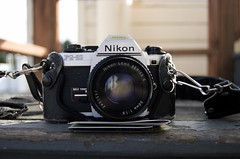 Nikon (Chase Ottney) Tags: sf california lighting ca camera wood roof light sunset portrait slr film rooftop leather 35mm vintage photography daylight photo nikon san francisco mechanical natural outdoor case strap gravel direct lense selftimer diffuse glassware fg20