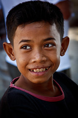 Boy with big smile (Rebecca Danby) Tags: people children cambodia tonlesap