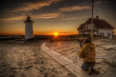 The Photographer (Frank C. Grace (Trig Photography)) Tags: light lighthouse sunrise ma photographer provincetown capecod massachusetts newengland flare sunrays hdr seagrass racepoint tonemapped pentaxart
