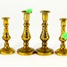 129. Three Pair of Miniature Antique Brass Candlesticks