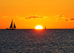 Crossing the Sun (David Pulgar) Tags: ocean sun clouds sailboat sunrise nikon waves florida miami atlantic schooner southbeach southpointe d300s