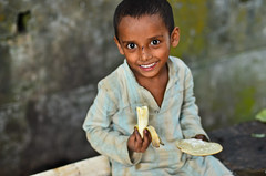 His breakfast (A. adnan) Tags: poverty street portrait colour beautiful smile smiling breakfast eyes nikon documentary banana bangladesh unedited chittagong nikkor50mmf14d nikon50mmf14d sooc bangladeshiphotographer d7000 peopleofbangladesh aadnan613