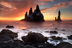 Burst of Sun - Reynsidrangar near Vk, Iceland (orvaratli) Tags: ocean sea rock sunrise landscape iceland waves atlantic arctic splash pinnacles seastack vk seacape reynisdrangar basaltcolumns arcticphoto reynsifjara