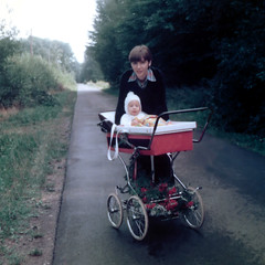 Mother with her Baby Boy during a Walk (Batikart ... handicapped ... sorry for no comments) Tags: street boy portrait people orange woman baby brown tree green nature smile face vintage germany geotagged happy deutschland kid bush europa europe child walk mother son walkway buggy ursula 1976 2012 sander rolleicord niedersachsen lowersaxony babystroller diepholz batikart fototrove