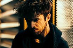 Stripes (David Pinzer) Tags: portrait people man face dark pattern shadowplay emotive lightplay