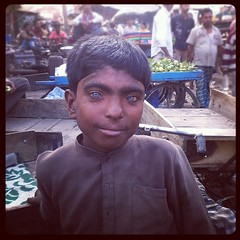 Boy with blue eyes (Lil [Kristen Elsby]) Tags: boy portrait india square topf50 child market delhi indian blueeyes squareformat bazaar iphone southasia jamamasjid olddelhi topv7777 meenabazaar iphone4 iphoneography instagram instagramapp