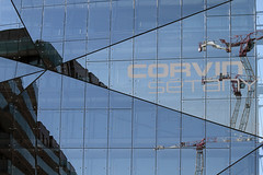 reflection of an urban renewal project (wunderskatz) Tags: new urban reflection heritage glass modern project mall europe hungary crane destruction budapest central architectural arcitecture renewal buliding corvin szigony
