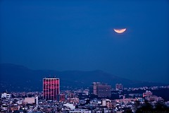 the lunar eclipse beyond pendeli (helen sotiriadis) Tags: city sky moon night canon landscape eclipse published cityscape athens greece lunareclipse penteli canon70200f28lisusm pendeli canoneos40d