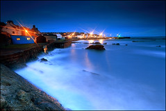 St Monans - Harbour Lights & the Blue Hut (angus clyne) Tags: ocean blue light sea sky house fish storm building beach st wall night coast scotland boat fishing break bright angus north scottish wave spray east forth hour firth clyne monans