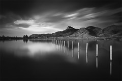 Chasing Light and Shadows (239 Seconds) (DavidFrutos) Tags: longexposure sea bw costa seascape beach water monochrome clouds sunrise postes landscape monocromo coast mar agua post playa paisaje bn murcia amanecer filter le lee nubes poles canondslr filtro largaexposicin filtros calblanque neutraldensity canon1740mm gnd8 graduatedneutraldensity densidadneutra davidfrutos 5dmarkii niksilverefexpro leebigstopper singhraygallenrowellnd3ss