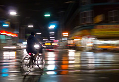 Night Rider (syncros) Tags: toronto rain night chinatown cyclist east ave handheld broadview lx5